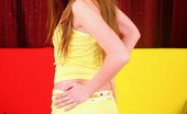 Nubiles Naney Cute Nubile Babe Naney In Yellow Outfit Teases Us With Her Beauty On The Couch