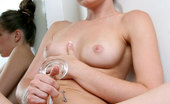 Nubiles Capri 243893 Naughty Teen Capri Enjoys Tortures Her Tight Pussy With A Glass Dildo