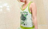 Nubiles Natalia Blonde Pretty Flirt Natalia Slides Her Tops And Posing So Hot On The Bathroom