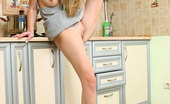 Nubiles Kesia Amazing Teen In The Kitchen Posing With An Upskirt View Of Her Fresh Pussy