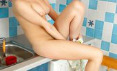 Nubiles Viktoria Luscious Teen Hottie Viktoria Poses Her Well Shaved Juice Box In The Kitchen