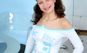 Nubiles Olga Glamourous Sporty Teen On Chair With Braced In Teeth Temptingly Shows Flowered Panty