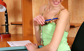 Nubiles Emanuelle College Babe At Her Study Table Shows Some Tight Curves On Cam