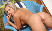 Nubiles Jenni Teen Jenni Stripping Her Bikini And Exposing Trimmed Pussy On Couch