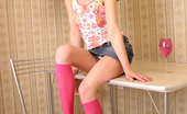 Nubiles Trinity Perfect Face Teen Smiles At The Cam Teasing Good And Posing On The Table