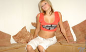 Nubiles Denisa Denisa Looks Cute On Her Clothes And Posing Hot On Couch She'S Too Nice