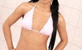 Nubiles Toni Tanned Coed Teen In Pink Bikini Getting Herself Wet On The Bathtub