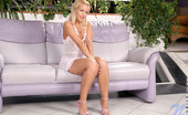 Nubiles Candy Hot Cute Model With Her Legs Spreads Feeling Her Cover Chest Seductively