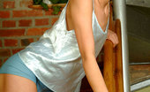 Nubiles Nadine Arousing Cute Teen Slowly Sliding Off Her Tops And Posing Really Hot
