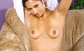 Nubiles Reena Totally Naked Nubile Reena Gingerly Squeezing Her Tempting Jugs On The Sofa