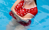 Nubiles Florencia Alluring Teen Enjoys Swimming And Teasing With A Red Roses Petals On Pool