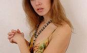 Nubiles Emanuelle Seductive College Girl Admires Herself In A Flimsy Summer Dress