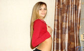 Nubiles Katrina Katrina In Black Miniskirt With Her Panty Exposed Licking And Plopping Lollipop