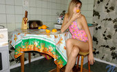 Nubiles Katrina Wow Katrina Wearing Just Apron And Thongs While Eating Orange Looks Very Juicy
