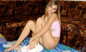 Nubiles Katrina Stunning Teen Babe In Pink Sitting Hot And Cute On Blue Mat