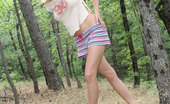 Nubiles Milana Well Endowed Teen Stripper All Fired Up To Pose Naked In The Woods