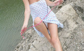 Nubiles Milana Lovely Milana Gently Strokes Her Blonde Hair Before Stripping Off The Lake