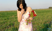 Nubiles Holly Lovely Teen Hottie Just Pick Up Some Fresh Flowers In The Field And Posing