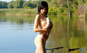 Nubiles Holly 248588 Alluring Holly Stripping All Her Clothes Till Gets Totally Naked In The Lake