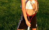 Nubiles Belinda A Perfect Sporty Teen Chick Posing With Her Tennis Racket On Grassy Playground
