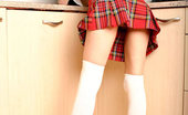 Nubiles Taylor Schoolgirl Teen Babe In Uniform Giving A Bit Of Upskirt View In The Kitchen