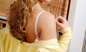 Nubiles Cristal Hottie Sits And Smiles With Her Golden Curls Down And Her Badminton Racket Out