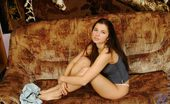 Nubiles Danica Danica Sits And Looks Sweet In Just Her Panties And A Tshirt You Can See Her Bush Almost