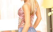 Nubiles Carrie 251299 Sexy Teen Carrie Has Her Long Blond Hair Down And Bends Over With Her Tight Shorts On Showing Her Very Tight Ass