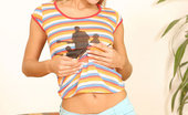 Nubiles Carrie Precious Blonde Hottie Carrie Sits In Stripes And Plays And Teases Her Small Titties For All To See