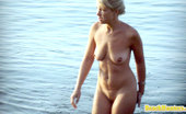 Beach Hunters Nudist Blonde MILF Nudist MILF Caught On Hidden Beach Cam Brushing Her Teeth In The Water