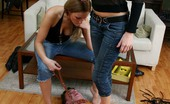 Under Feet Two Bitches In Tight Jeans Trample A Freak And Use Him For An Ashtray