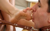 Under Feet Slave Cleans The Dirty Feet Of His Mistresses With His Tongue In Exchange For A Handjob