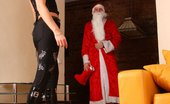 Under Feet Two Seductive Horny Girls Turn Santa Claus Into Submissive Helpless Slave