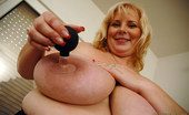 Only Big Melons June Kelly Suction Pumps Her Nipples And Weights Her Puppies