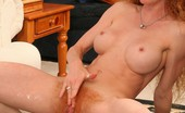 The Mother Fucker A Redhead Milf In Shades Has Her Natural Pussy Pounded