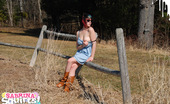 Sabrina Squirts Wearing A Cute Blue Dress And Cowboy Boots, Sabrina Ventures Outside On Another Sunny Spring Day To Show Off Her Goods For The Camera. Cute!