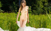 Showy Beauty Elise Caress Girlfield Gorgeous Slim Girl Posing Absolutely Naked Outdoor In The Field On The Plastic Sheeting.