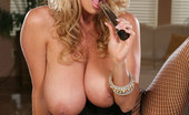 Kelly Madison Animal Instincts Kelly In Black Lingerie Tears Open Her Fishnets And Rubs On Her Clit With Silver Vibrator.