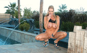 Kelly Madison Slick Blonde Kelly Oils Up And Can'T Keep Her Bikini In The Right Place Her Tits Keep Falling Out.