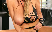 Kelly Madison Oooh Barracuda Kelly Uses A Leather And Crystal Dildo While Wearing A Black Bikini.