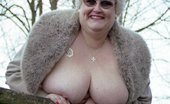 UK Flashers Fat Granny Posing Nude In A Park