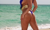 Diamond Kitty Blue One-Piece On The Beach