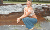 Shelby Bell Sensual Blonde Shelby Bell Posing Outdoors In Blue Jeans