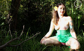 Girls Out West Stellar In The Garden Stelllar Squats In The Long Grass Wearing A Pretty Green Summer Dress. The Sun Kisses Her Body, She Pops Her Tits Out, Airing Them, Touching Them, The Nipples Become Erect.