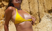 Girls Out West Petria Cliffside Petria, Tanned, And Stunning, In Yellow Bikinis Is Horny As Fuck To Wank On The Cliffside. Flashing Her Naughty Bits At The Camera, And Getting Worked Into A Healthy Sweat, She Finds A Nice Rock To Perch On, Open Up, And Play With Her World Famous Pussy.