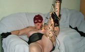 TAC Amateurs Big Black Corset Full Length Black Corset And Stockings, And A Little Red Feather Mask To Top It All Off.