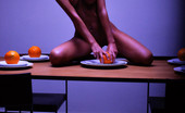 X-Art Nella Orange Crush In A Symphony Of Light, Shadow & Color, Nella Squeezes The Juice Of An Orange And Lets It Drip All Over Her Naked Body.
