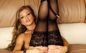 Danni.com Rita Faltoyano Lingerie Babe Rita Faltoyano In Black Stockings Unwraps Her Wonderful Body