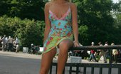 Upskirt Collection Lewd babe stretches hips and shows white panties in public