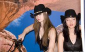Upskirt Collection Two frisky girls in cowboy hats slap asses in jeans shorts